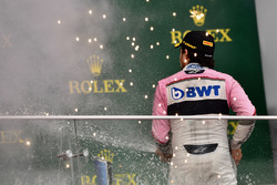 Third place Sergio Perez, Force India celebrates on the podium with the champagne