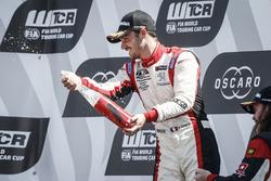 Podium: Race winner Aurélien Comte, DG Sport Competition Peugeot 308TCR