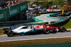 Sebastian Vettel, Ferrari SF70H, passes Valtteri Bottas, Mercedes AMG F1 W08, at the start