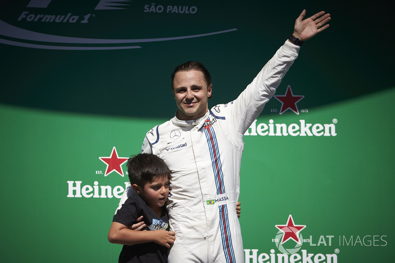 Felipe Massa, Williams, with his son Felipinho waves to his home fans from the podium after his fina