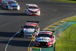 Richie Stanaway, Tickford Racing Ford, battles with Simona de Silvestro, Nissan Motorsport Nissan, ahead of James Golding, Garry Rogers Motorsport Holden, and Todd Hazelwood, Matt Stone Racing Ford