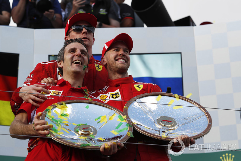 Race winner Sebastian Vettel, Ferrari celebrates on the podium with Kimi Raikkonen, Ferrari and the