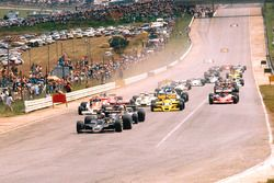 Mario Andretti, Lotus 78 Ford leads Jody Scheckter, Wolf WR1 Ford, Nikim Lauda, Brabham BT46 Alfa Ro