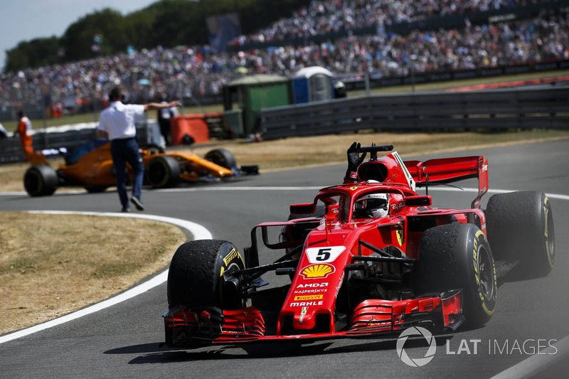 Race winner Sebastian Vettel, Ferrari SF71H, celebrates on his way to Parc Ferme
