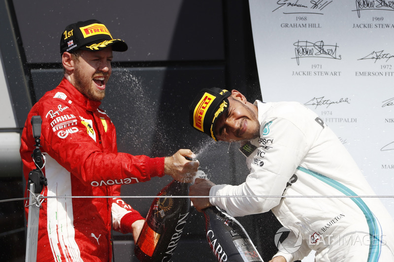 Race winner Sebastian Vettel, Ferrari and Lewis Hamilton, Mercedes AMG F1 celebrate on the podium