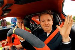 Nico Rosberg Checks Out Collection Of Porsches