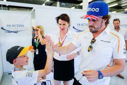 Fernando Alonso, McLaren, high fives a child