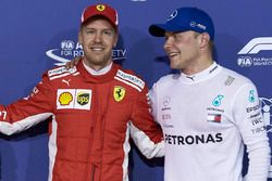 Pole man Sebastian Vettel, Ferrari, with Valtteri Bottas, Mercedes AMG F1