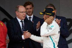 Prince Albert of Monaco greets Lewis Hamilton, Mercedes AMG F1, on the podium