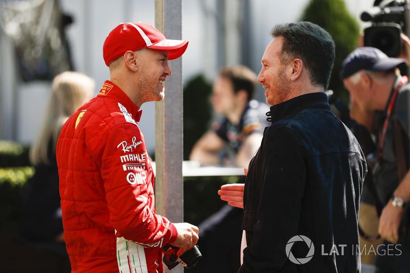 Гонщик Ferrari Себастьян Феттель и руководитель Red Bull Racing Кристиан Хорнер
