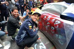 Daniel Ricciardo, Red Bull Racing with the street art styled Aston Martin DB11 and Street Artist Jul
