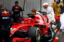 Lewis Hamilton, Mercedes AMG F1, studies the Kimi Raikkonen, Ferrari, after qualifying