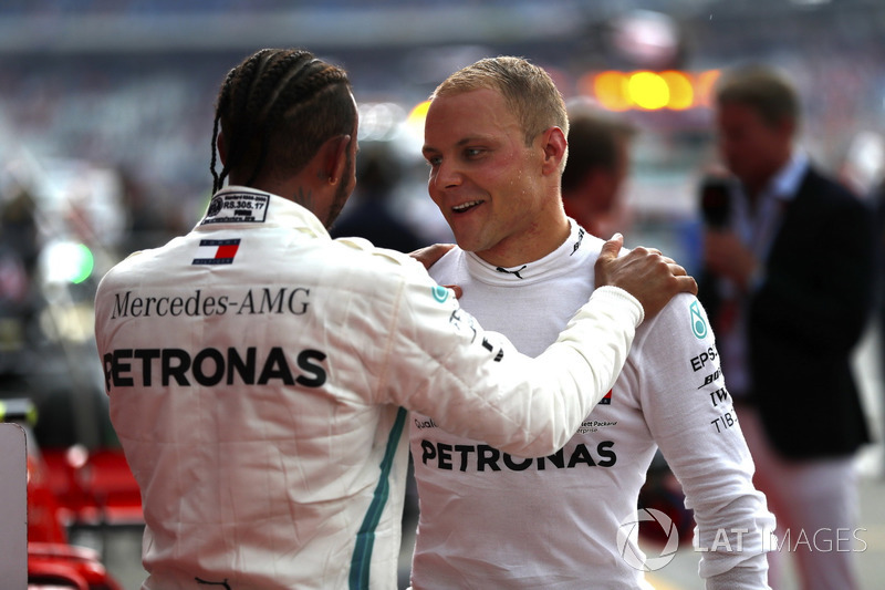 Lewis Hamilton, Mercedes AMG F1, celebrates victory in parc ferme, with Valtteri Bottas, Mercedes AMG F1