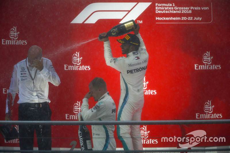 Race winner Lewis Hamilton, Mercedes AMG F1, second place Valtteri Bottas, Mercedes AMG F1, and Dr Dieter Zetsche, CEO, Mercedes Benz, celebrate with Champagne on the podium