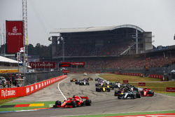 Sebastian Vettel, Ferrari SF71H, leads Valtteri Bottas, Mercedes AMG F1 W09, Kimi Raikkonen, Ferrari SF71H, Max Verstappen, Red Bull Racing RB14, Nico Hulkenberg, Renault Sport F1 Team R.S. 18, at the start of the race