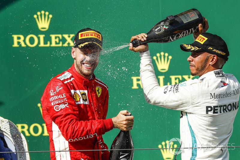 Lewis Hamilton, Mercedes AMG F1, 1st position, sprays Sebastian Vettel, Ferrari, 2nd position, with Champagne