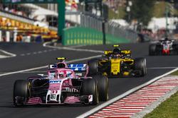 Esteban Ocon, Force India VJM11, leads Carlos Sainz Jr., Renault Sport F1 Team R.S. 18, and Romain Grosjean, Haas F1 Team VF-18