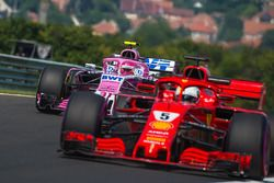 Esteban Ocon, Force India VJM11 and Sebastian Vettel, Ferrari SF71H