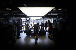 Engineers reposition a car in the garage