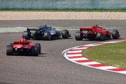 Kimi Raikkonen, Ferrari SF71H, Valtteri Bottas, Mercedes AMG F1 W09, and Sebastian Vettel, Ferrari SF71H