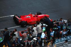 Michael Schumacher, Ferrari F300 crosses the line to win the race