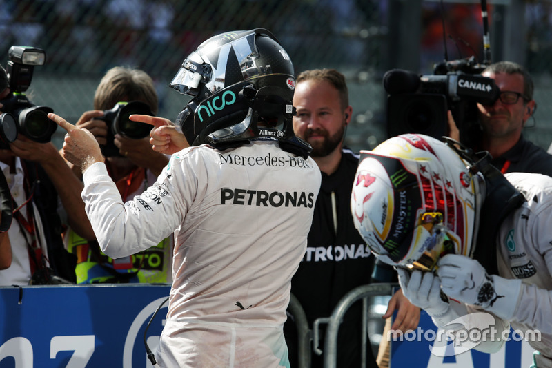 Race winner Nico Rosberg, Mercedes AMG F1 celebrates in parc ferme as his third placed team mate Lew