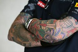 Red Bull Racing mechanic with tattoos