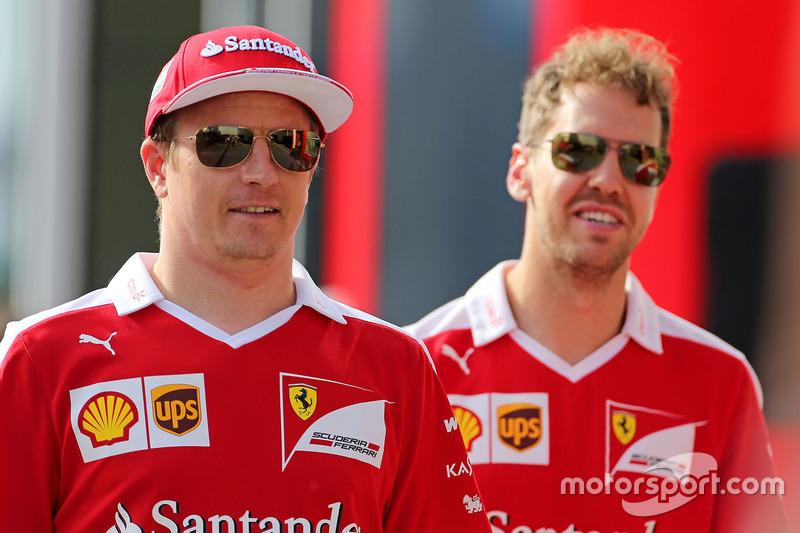 Kimi Raikkonen, Scuderia Ferrari and Sebastian Vettel, Scuderia Ferrari