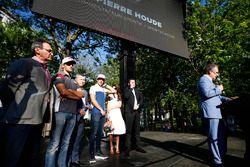 Pierre Houde, Commentator on stage, Romain Grosjean, Haas F1 Team Lance Stroll, Williams. and Eric B