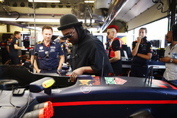 The Black Eyed Peas receive a tour of the Red Bull garage. Christian Horner, Team Principal, Red Bul