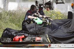 Romain Grosjean's Haas F1 Team VF-17 is returned to the pits