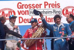 Niki Lauda, 1st position, Jody Scheckter, 2nd position and Hans-Joachim Stuck, 3rd position on the p