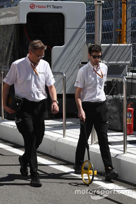 McLaren engineers measuring the track