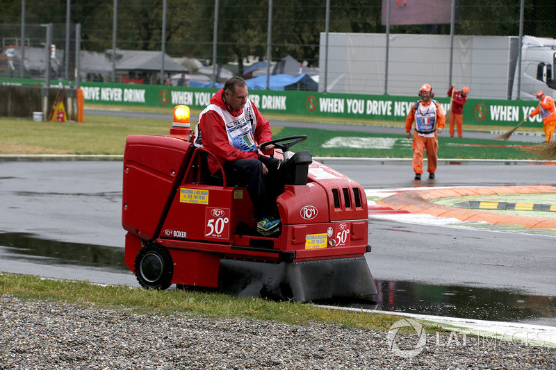 Marshal removes water from the track