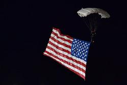 Pre-race American flag parachuter