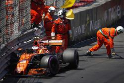 Marshals clear the wreckage after Stoffel Vandoorne, McLaren MCL32, crashes