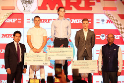 MRF Challenge champion Harrison Newey, second place Joey Mawson, third place Mick Schumacher with Sachin Tendulkar and Arun Mammen, MRF Managing Director and Executive Director