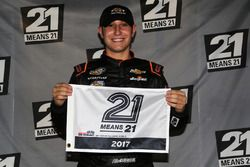 Kaz Grala, GMS Racing Chevrolet, poses with the pole award