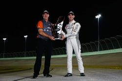 Champion Daniel Suarez, Joe Gibbs Racing Toyota with his crew chief Scott Graves