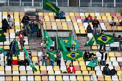 Chinese fans wave Brazilian flags