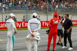 Polesitter Valtteri Bottas, Mercedes AMG F1, tweede plaats Sebastian Vettel, Ferrari, derde plaats L