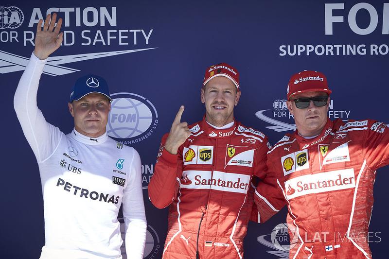 Топ-3 кваліфікації: володар поул-позиції Себастьян Феттель, Ferrari, друге місце Кімі Райкконен, Fer