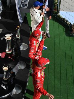 Podium: race winner Sebastian Vettel, Ferrari, second place Kimi Raikkonen, Ferrari, third place Valtteri Bottas, Mercedes AMG F1