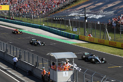 Valtteri Bottas, Mercedes-Benz F1 W08 Hybrid and Lewis Hamilton, Mercedes-Benz F1 W08 Hybrid take the chequered flag