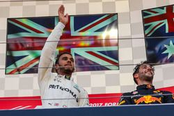 Race winner Lewis Hamilton, Mercedes AMG F1 celebrates on the podium alongside Daniel Ricciardo, Red