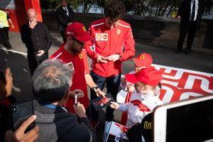 Sebastian Vettel, Ferrari, Mattia Binotto, Team Principal Ferrari sign autographs for the fans