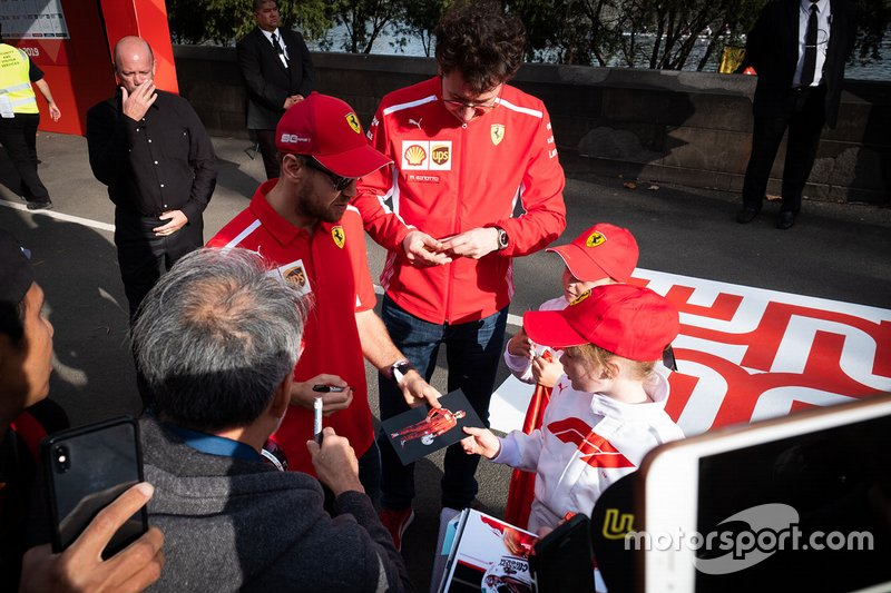 Sebastian Vettel, Ferrari, Mattia Binotto, Team Principal Ferrari sign autographs for the fans