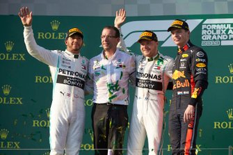 Lewis Hamilton, Mercedes AMG F1, 2nd position, the Mercedes Constructors delegate, Valtteri Bottas, Mercedes AMG F1, 1st position, and Max Verstappen, Red Bull Racing, 3rd position, on the podium