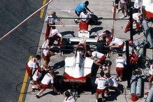 Alain Prost, McLaren MP4-5, makes a pit stop