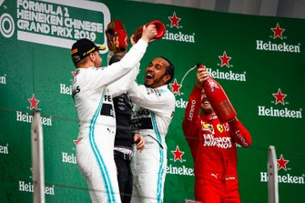 Valtteri Bottas, Mercedes AMG F1, 2nd position, Lewis Hamilton, Mercedes AMG F1, 1st position, and Sebastian Vettel, Ferrari, 3rd position, on the podium
